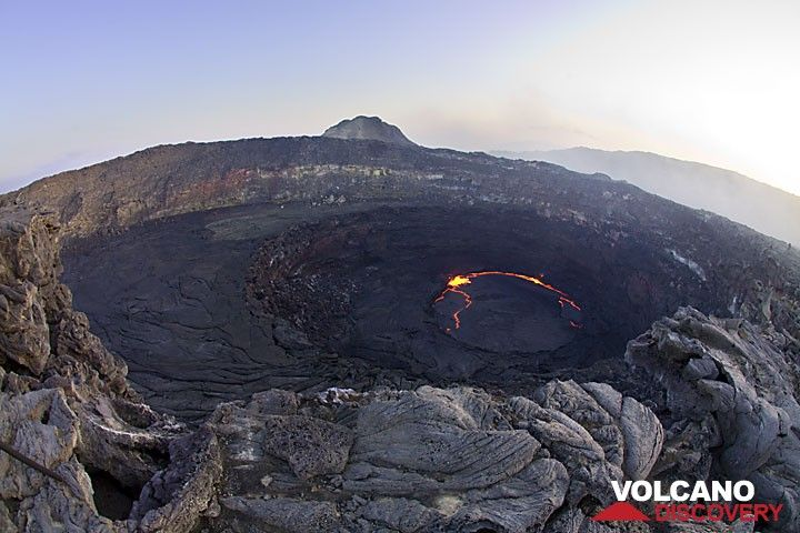 The active lava lake, about 75 m in diameter, is inside the north pit crater. (Photo: Tom Pfeiffer)