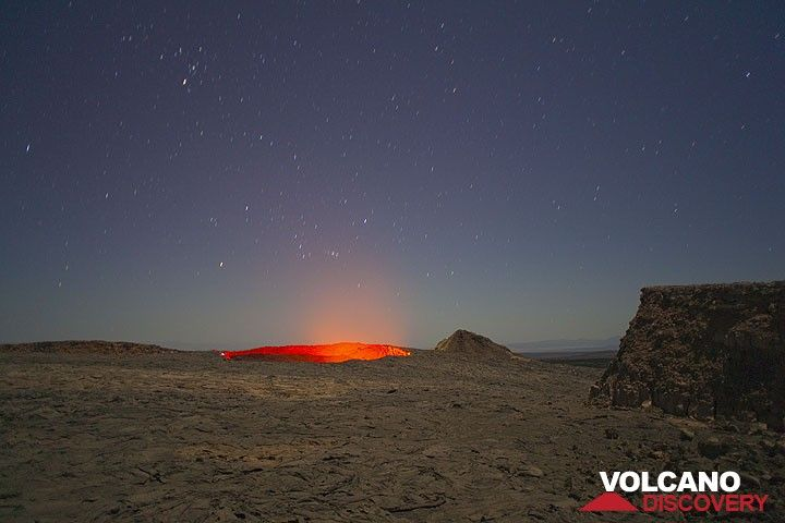 The caldera of Erta Ale with the active lava lake beneath a moon-lit sky. Orion above the lava lake. (Photo: Tom Pfeiffer)
