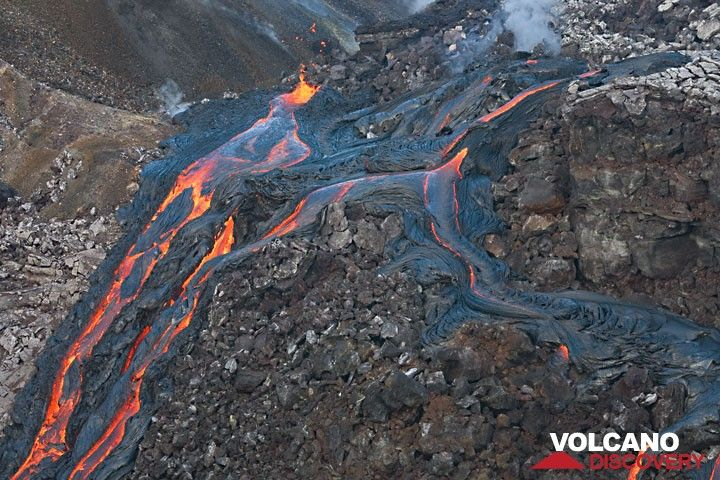 Three other vents, one strongly spattering, the other two (upper right) only emitting weak lava flows.  hawaii_e7315.jpg (c)
