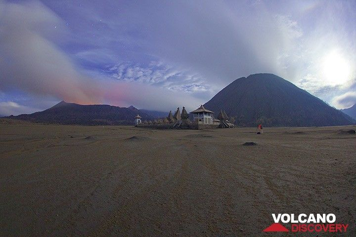 Bromo and the Hindu temple at its feet in a moonlit night. Jorge has his camera set up for the next eruption. (Photo: Tom Pfeiffer)