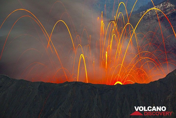 View onto Bromo crater with a strong strombolian eruption in bright moonlight. The ash, blurred in the long exposure, hides many blocks. (Photo: Tom Pfeiffer)