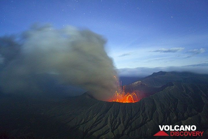 Panoramic view over Bromo volcano in strombolian activity at night. The ash plume is drifting eastwards. (Photo: Tom Pfeiffer)