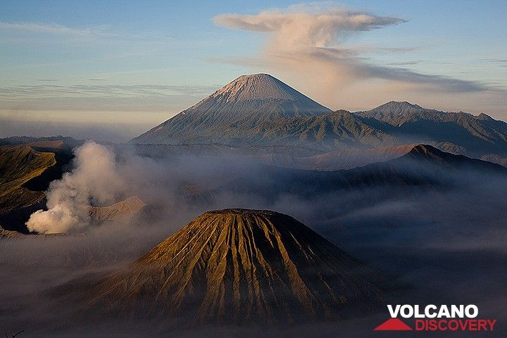 Volcanic trio: Batok cinder cone, smoking Bromo, and majestic Semeru with an umbrella cloud (c)