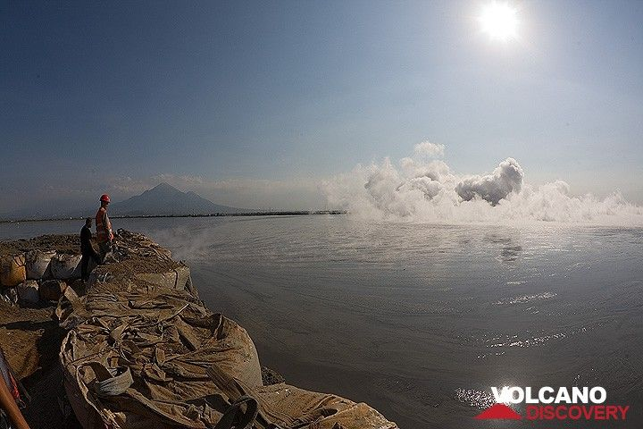 On the dam surrounding the mud vent. Penanggungan volcano in the background. (Photo: Tom Pfeiffer)