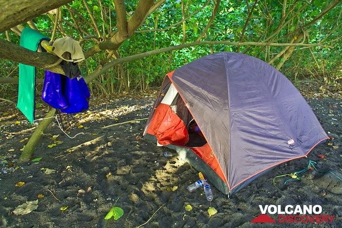The VolcanoDiscovery camp site on Rakata island in July 2009. A great place to relax! In the morning you see wild monitors and at night you listen to the sound of erupting Anak Krakatau. A phantastic experience! (Photo: Tobias Schorr)