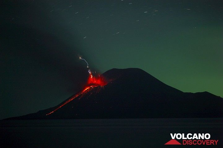 Eruption with strong lightning at night. (c)