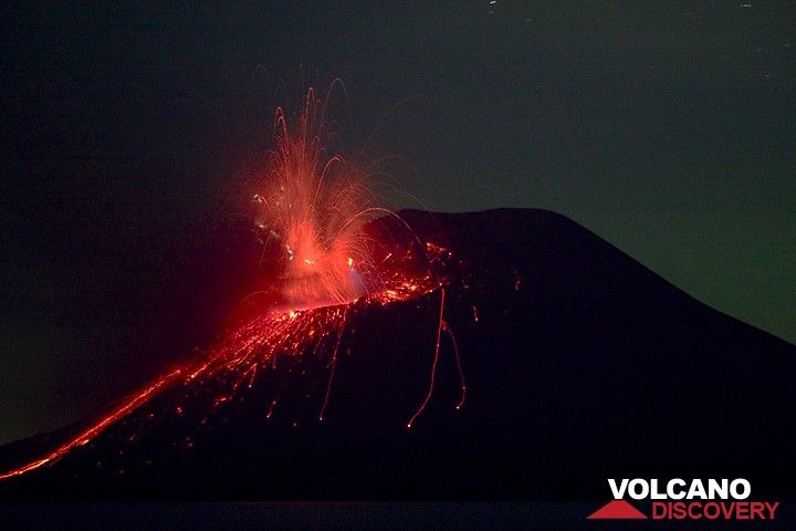 Night-time eruption with many small lightnings in the eruption plume. (c)