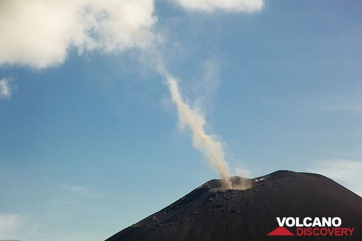 A little tornado of ash forming from a large eddy in the air above the crater. (Photo: Tom Pfeiffer)
