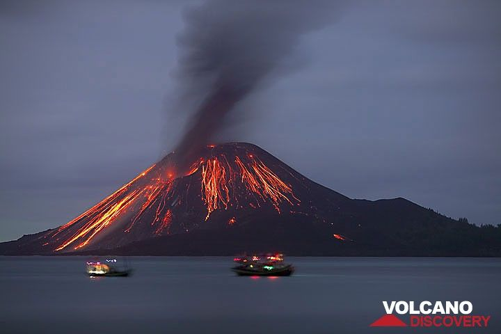 Two fishing boats in front of the cone after a stronger explosion. (22 Nov) (c)