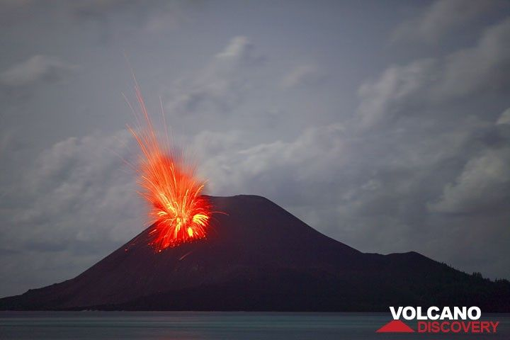 Early on 24 Nov: a bright initial blast from an eruption sends bombs high up into the air.  (c)
