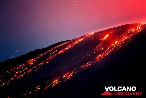 Lava flows travelling down on Etna volcano's western flank. (c)
