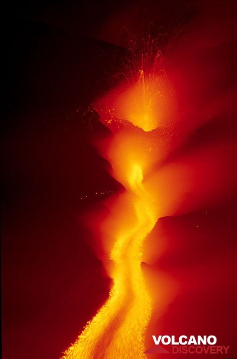 The lava flow and spattering at the 2100 m vent at night. (c)