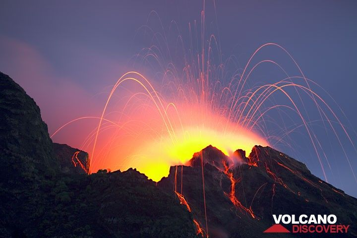 Typical strombolian eruption from the NE crater - incandescent bombs fall onto the outer slopes of the crater and start to roll down the Sciara del Fuoco (c)