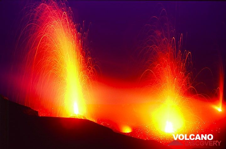 Strong eruption from the NW crater, simultaneous with an eruption from a central crater vent; several other active vents glowing. Photo taken on 28 June 2006. (c)