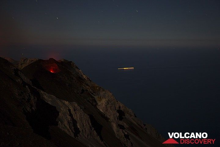 NE crater with glowing vents at night. A ship is passing in the background over the Tyrrhenian Sea. (Photo: Tom Pfeiffer)