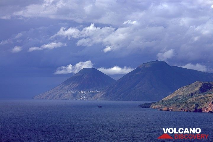 Salina's volcanoes Monte dei Porri and Monte Fossa delle Felci in the background against the approaching storm front.  (Photo: Tom Pfeiffer)