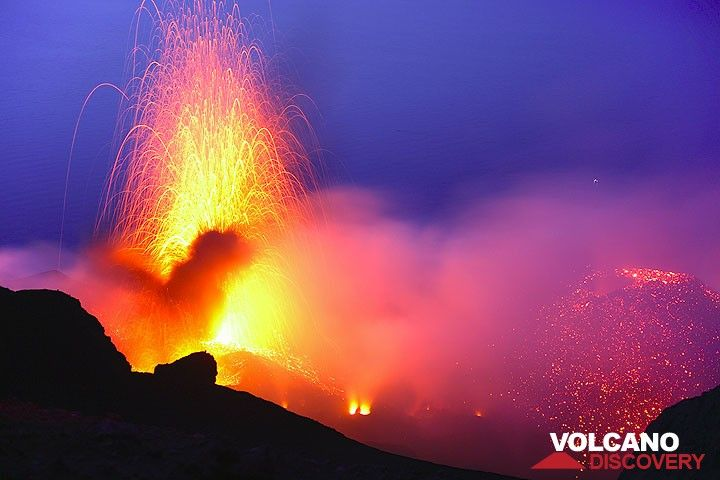 Eruption from Stromboli's NW crater (April 2009). Note the prominent new cone in the eastern (right) part of the crater, created by activity of the NE vents. (Photo: Tom Pfeiffer)