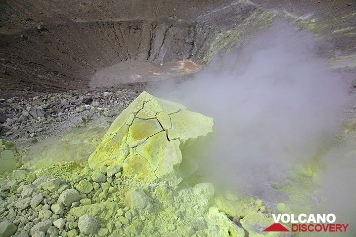 Sulphur crusted breadcrust bomb on the rim of Fossa volcano's crater, Vulcano Island (Photo: Tom Pfeiffer)