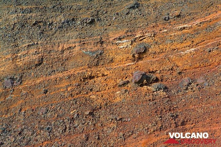 Layers of red scoria lapilli and bombs exposed at the red beach (Photo: Tom Pfeiffer)