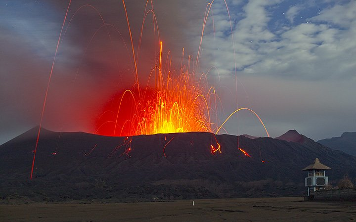 Strombolian eruption at Mt. Bromo volcano in Feb 2011 - this photo was selected for the 2012 IAVCEI volcano calendar. (Photo: Tom Pfeiffer)