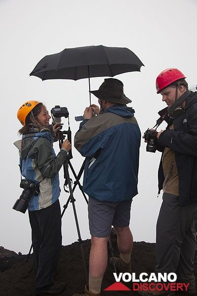 It's light rain up here at the Marum crater rim,- actually, this is still good weather and we're in good humour. (Photo: Tom Pfeiffer)