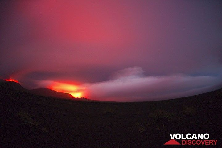 Thunderstorms are frequent above Ambrym. Here, the lava lakes in the craters illuminate a rain cloud hovering above the caldera. (Photo: Tom Pfeiffer)