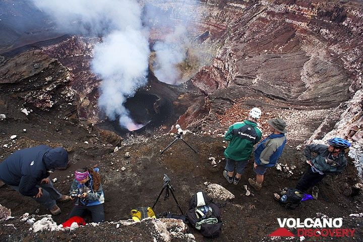 The group perched on a ledge above the craters. (Photo: Tom Pfeiffer)