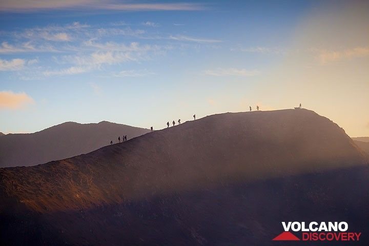 Tourists climbing the summit rim of Yasur volcano at sunset (Photo: Tom Pfeiffer)
