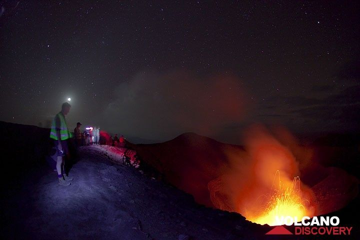 Volcano watchers on the rim of Yasur, above the active craters at night. (Photo: Tom Pfeiffer)