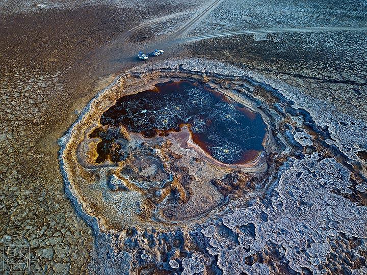 Aerial view of salt deposits and a large acid pond near Assale salt lake and Dallol (Photo: Stefan Tommasini)