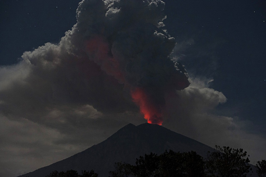 Red Lava Glow Is Reflected In The Thick Smoke Emanating From Mount Agung As Seen