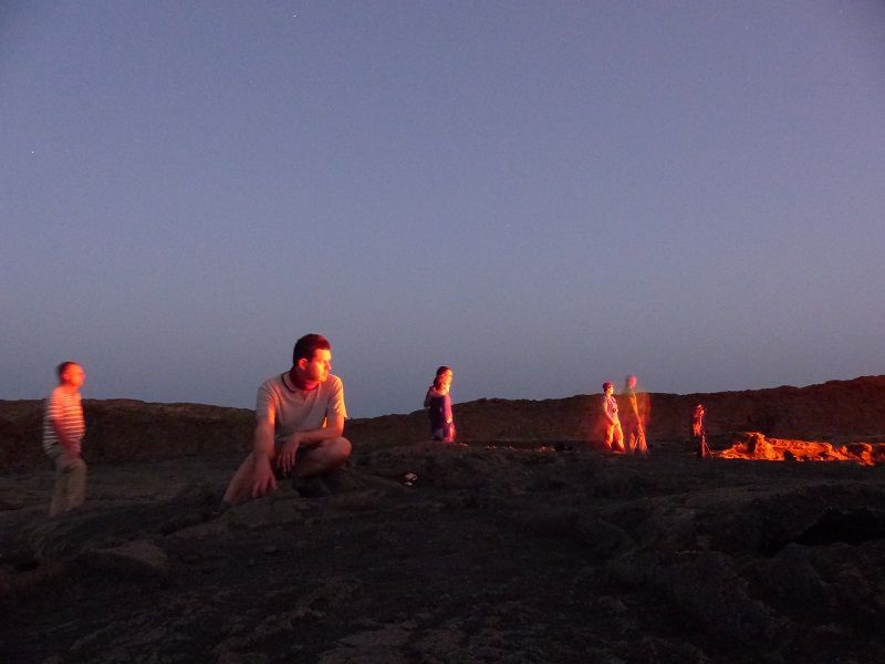 Watching the lava lake of Erta Ale at dusk (image: Ingrid Smet / VolcanoAdventures)