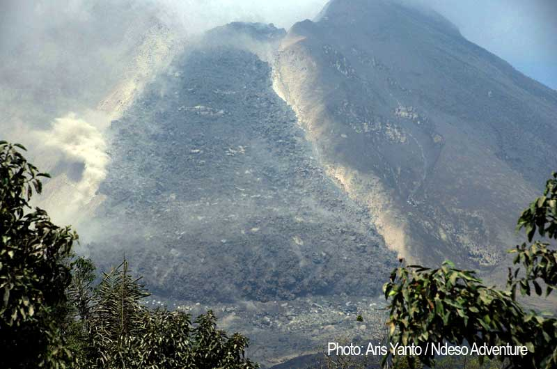 The lava flow from Sinabung has reached the base of the mountain