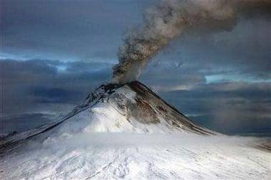 Augustine volcano emitting ash on 12 Jan. 2006, photographed from the west. (Photo: Game McGimsey/Alaska Volcano Observatory/U.S.G.S.)