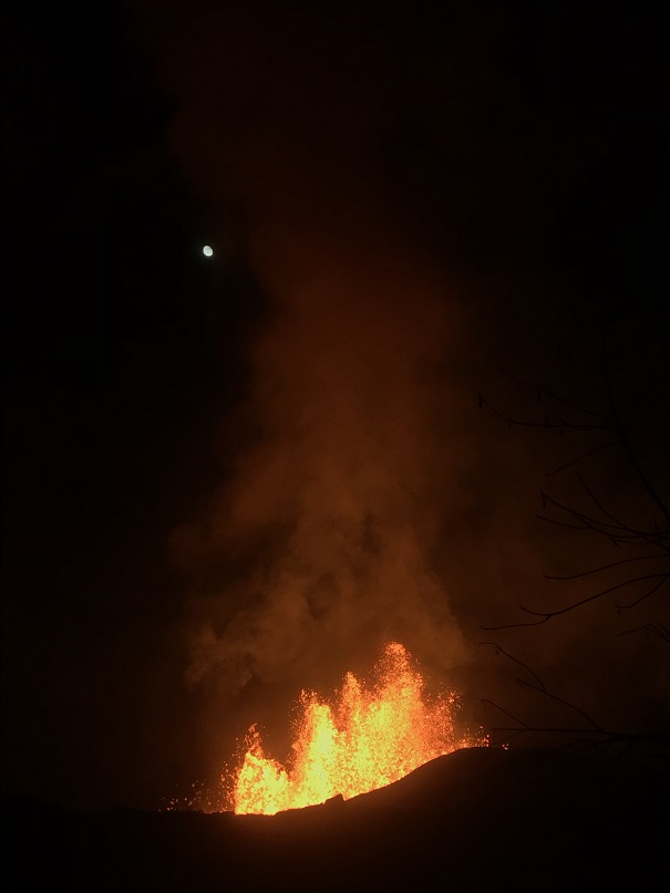 Although continuously active, lava fountaining from fissure 8 temporarily decreased to heights of about 50 m (164 feet) during the night from 1 to 2 June . The moon can be seen in the upper left. (HVO/USGS)