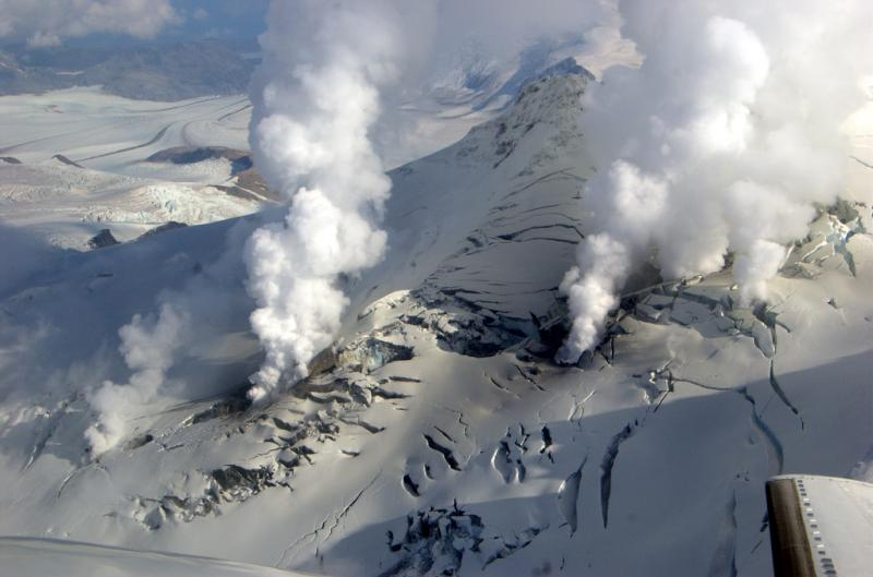 Aerialphoto of the summit of Fourpeaked volcano on an overflight on the 24th of Sep 2006 showing several steaming vents on its summit. (Photo courtesy: Cyrus Read, AVO/USGS)