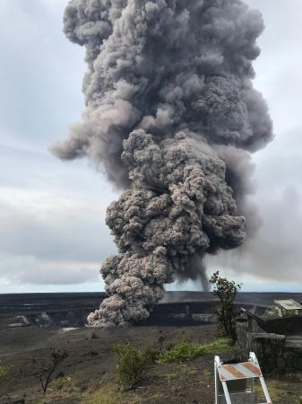 Ash column rises from the Overlook crater at the summit of Kīlauea Volcano. HVO's interpretation is that the explosion was triggered by a rockfall from the steep walls of Overlook crater. The photograph was taken at 8:29 a.m. HST from the Jaggar Museum overlook. The explosion was short-lived. Geologists examining the ash deposits on the rim of Halema'uma'u crater found fresh lava fragments hurled from the lava lake. This explosion was not caused by the interaction of the lava lake with the water table. When the ash cleared from the crater about an hour after the explosion, geologists were able to observe the lava lake surface, which is still above the water table. (image: HVO / USGS)