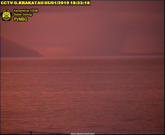 Krakatoa seen this afternoon at sunset - the plume from Anak Krakatau is visible as a dark looming shadow (image: VSI webcam)