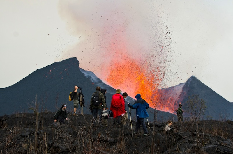 The VolcanoDiscovery group at the erupting flank cone of Nyamuragira volcano (8 Jan 2012)