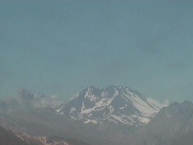 Ash just visible in background in this grab from the Sernageomin webcam. Credit: Sernageomin.