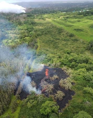 aerial view of fissure 16, located about 1.3 km (0.8 miles) northeast of fissure 15 (top left). The fissure is located 500 m northeast of the Puna Geothermal Venture site (top right). Photograph courtesy of Hawai`i County Fire Department. (via HVO / USGS)