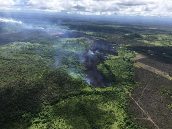At 2:30 p.m. HST, the flow front of Fissure 17 continues down slope. The barren, brown area to the right in the photograph is a lobe of the Kii Flow from the eruption of 1955. The Fissure 17 flow front is located approximately .7 miles makai of Highway 132 and is 1.4 miles mauka of Hwy 137. (image: HVO / USGS)
