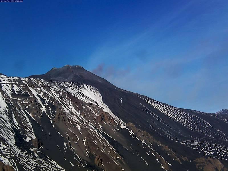 Ash plume rising from the (hidden) NE crater of Etna this morning (Etna Trekking webcam Schiena dell'Asino)