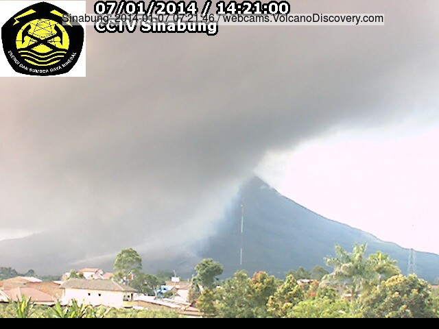 Ash plume from a pyroclastic flow this morning and the delta of the fresh pyroclastic deposits at th SE foot of Sinabung